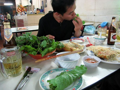 Hai tucking in to a banh xeo
