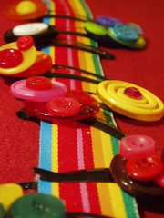Button barrettes on rainbow ribbon 3