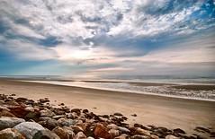 Low Tide (ski 9) Tags: nhnew englandfieldfogmorningsunriseviewspring beach sand rocks sky clouds sun maine ogunquit d200 nikon sigma1020mm weeklysurvivor