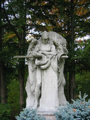 A statue of the Archangel Michael (thomas alan) Tags: cemetery angel cleveland tombstone gravestone johnhay archangelmichael lakeviewcemetery jamesearlefraser