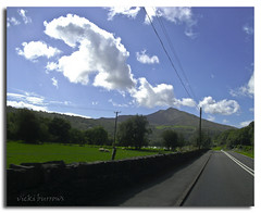 SNOWDON IN THE DISTANCE.... (vicki127.) Tags: road blue friends sky mountain holiday green grass wall wales clouds sheep powerlines telephonelines greatshot twop youmademyday flickraward lightroom3 concordians ilovemypics august2010 mygearandme photoshopcs5 ringofexcellence vickiburrows fujia235