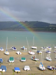 rainbow over new quay (piersbarber) Tags: sea beach wales boats coast rainbow fishing sand harbour newquay