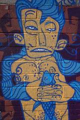 Fish Hugger (Canis Major) Tags: fish streetart bristol hugging squeezing yaka noscorehere