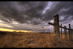 Stormy Clouds (Josh Sommers) Tags: sunset sky storm field grass clouds fence dramatic straw hay hdr photomatix tonemapped 3exp weekendamerica