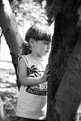 Hide and seek (Danni Guzzi Schmidt) Tags: boy bw white black tree canon eos rebel sadness child daniela melancholy guzzi xsi zwicker 450d dzguzzi