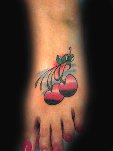 cherry tattoo design and like this image place for girl foot tattoo design