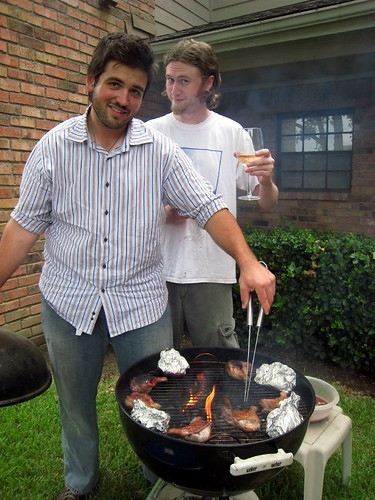 Husbear grilling while Kyle offers him a tasty beverage