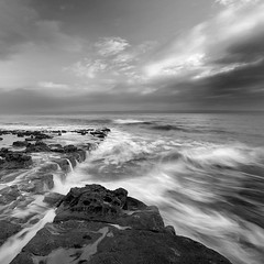 Monknash Rocks I (Adam Clutterbuck) Tags: ocean uk greatbritain sea blackandwhite bw seascape motion monochrome wales square landscape mono coast blackwhite rocks waves unitedkingdom britain wave bn coastal shore elements glamorgan gb bandw sq surge oe nashpoint greengage monknash heritagecoast adamclutterbuck sqbw bwsq showinrecentset walglamheri openedition