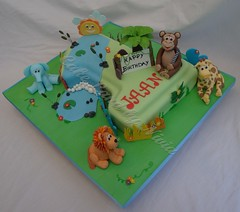 Jungle cake (CakeLand by Nivia) Tags: flowers blue elephant tree green animals cake one monkey shaped lion number jungle giraffe figurine