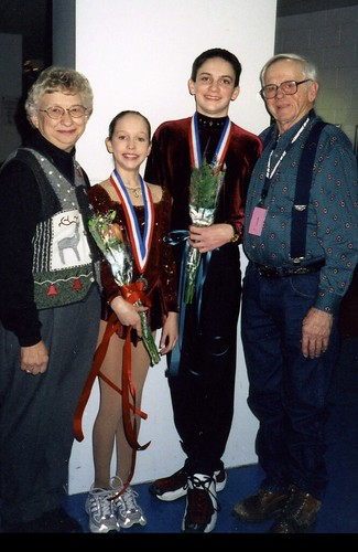 Grandma Judy and Grandpa Glenn with Christina (10) and Will (15) after the Intermediate Pairs Final at the 2000 Junior Nationals.