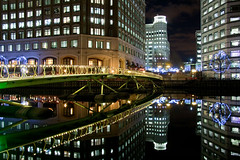 Footbridge at West India Quay (Katong Kate) Tags: lighting city bridge light england urban reflection london water night work buildings reflections dark lights reflecting evening dock footbridge capital quay docklands stillwater offices westindiaquay capitalcity londondocklands