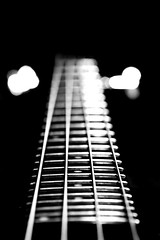 Sideways (Neville_S) Tags: blackandwhite bw music white black macro beautiful canon silver amazing fantastic focus glow bass bokeh guitar 4 100mm blackground instrument canon350d strings fret bassguitar f28 beats musicinstrument citizencope canon100mmmacrof28 nevillesukhiaphotography