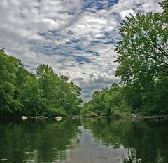 Kayaking the River (Kathy~) Tags: trees summer water clouds river kayak michigan mother annarbor huronriver cw thumbsup 2007 bigmomma superaplus aplusphoto photofaceoffwinner pfogold beautifulworldchallenges challengew herowinner