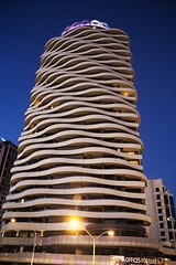 The Wave 2 (Erik K Veland) Tags: street blue light sky building architecture floors hotel streetlight darkness dusk wave australia explore lensflare queensland wavy magichour offices broadbeach interestingness321 i500