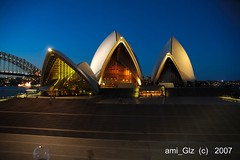 colourful. (Sydney Opera House) (ami_Glz /  .  /) Tags: bridge blue sky house color colour beautiful night lights harbor photo nikon opera d70 image sydney colourful sydneyoperahouse blueribbonwinner 10faves aplusphoto monthlythemegroupjun07
