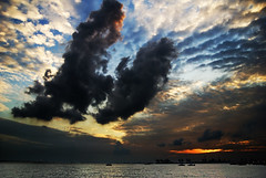 An otherwise beautiful sunset (sprintist86) Tags: blue light sunset shadow sea sky orange white water silhouette sign clouds dark landscape evening nikon skies dramatic pollution tamron d80 mywinners