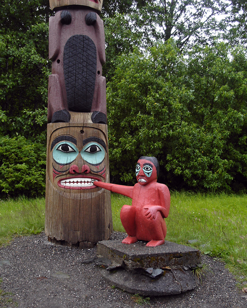 Boy Caught in Clam  (totem at Saxman, Alaska)