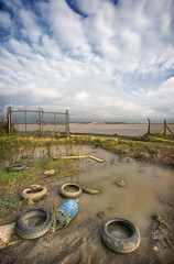 A Tired View Of The Humber (duncmc) Tags: sky broken water pool clouds trash fence river puddle bottle garbage gate mud rusty tire gas chainlink rubbish barbedwire flotsam canister derelict tyre humber wasteland eastyorkshire jetsam meltonforeshore