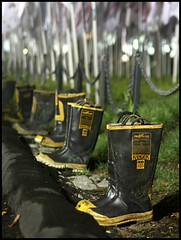 Thirsty Boots (Linus Gelber) Tags: nyc newyork memorial boots worldtradecenter 911 flags batterypark twintowers firemen fdny firefighters 911memorial firstresponders emptyboots thesemademecry