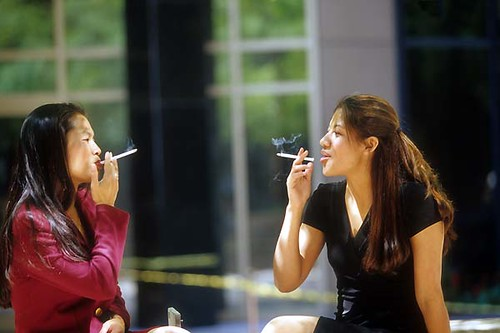 Asian and Latino women smoking