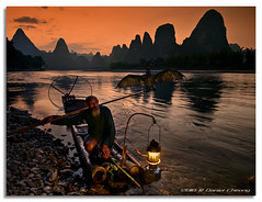 The Old Fisherman and his Cormorant [1] (DanielKHC) Tags: china old light sunset 2 portrait mountain fish man mountains bird lamp digital reflections river landscape li interestingness high fishing fisherman nikon dynamic dusk guilin yangshuo