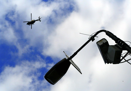 Helicopter + CCTV = big brother? but who cares? I dont personally. It's good for your security!