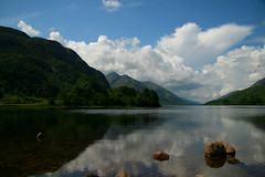Glenfinnan, by the Highlanders memorial (Angelrays) Tags: lake mountains reflection water clouds scotland bravo rocks loch coolest glenfinnan 25faves focuslegacy