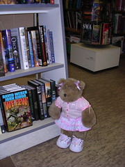 Felicia looking for books at Uncle Hugo's SF Bookstore