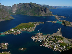 Reine - Lofoten Islands (Weg) (joepvanwyk) Tags: travel bridge sea mountain snow beautiful norway island coast boat fishing scenery tour village view harbour jetty north peak fjord scandinavia range lofoten reine polarcircle publication weg reinebringen