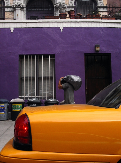 taxi and man carrying a bag