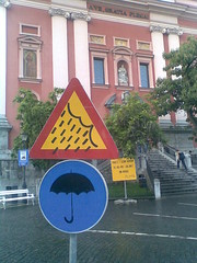 Ljubljana's own weather area (romanalilic) Tags: street art rain weather sign umbrella altered traffic creative slovenia ljubljana lubiana creativepeople