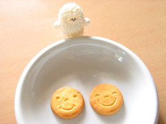 Baby treeson is so happy to meet the happy biscuits (Bubi Au Yeung) Tags: wood food baby white cute face japan table happy bubi plate biscuit snack dear wookie crazylabel treeson bubiauyeung