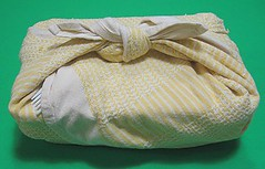 Box lunches wrapped in dish towel