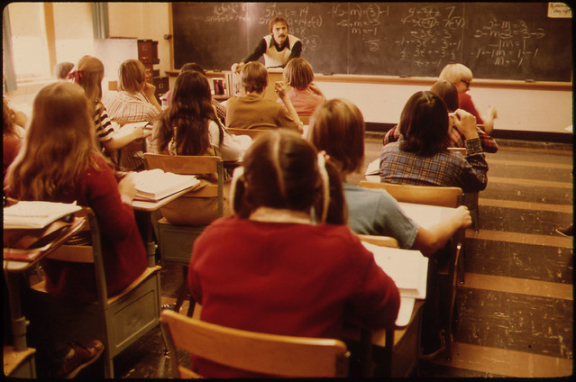 Students and Teacher in a Classroom at Cathedral High School in New Ulm, Minnesota...