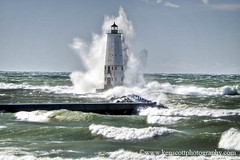 Frankfort LIght ... the Blow! (Ken Scott) Tags: usa lighthouse storm clouds waves wind michigan blow lakemichigan greatlakes breakers mitten freshwater frankfort naturesart benziecounty michiganmitt kenscottphotography kenscottphotographycom