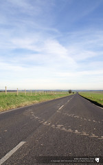 The road is long... (thinctanc) Tags: road blue summer sky white green grass lines clouds fence mud tracks clear salisbury posts plain cirrus whispy