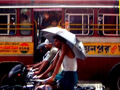 balancing umbrellas