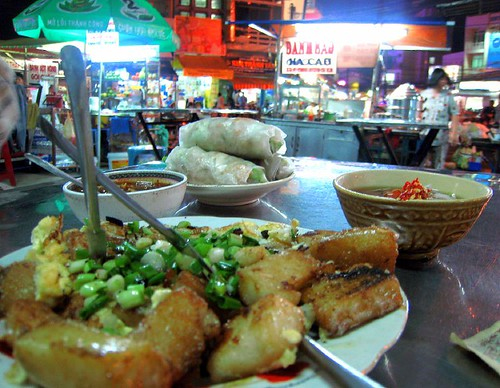 Bot Chien (fried rice cake) with goi cuon (spring rolls)