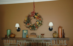 Fireplace mantel decorated for fall. (kizilod2) Tags: autumn brown green fall pumpkin fireplace rust paint turquoise books wreath decorating pear decor lowes mantle frankoma mantel finial sconces lauraashley picturerail picturehook oldgold6