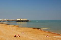 Hastings Beach, East Sussex (juliaclairejackson) Tags: sea summer seascape english beach coast pier town seaside british hastings eastsussex sunnyday sunbathe coastaltown seasidetown nikond80 superbmasterpiece