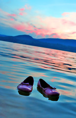 Floating Flats (boopsie.daisy) Tags: pink blue sunset sky lake mountains reflection beach beautiful shoes pretty floating flats ripples lovely float bows notphotoshoppedin mywinners abigfave wowiekazowie flickerdiamond colourartaward abstractartaward