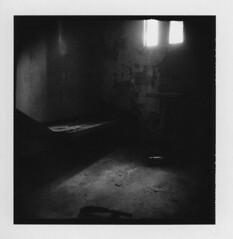 Solitary (Otto K.) Tags: atlanta bw abandoned film window polaroid blackwhite holga bed debris cell center prison squareformat jail holgaroid deserted decayed ue ubex pretrial detention type87 supershot artlibre ottok adoublefave