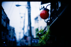 a red lamp (moaan) Tags: leica morning red summer house lamp 50mm dof midsummer bokeh hometown august osaka leicam7 2007 earlyinthemorning m7 midwifery redlamp f095 kodakektachrome64 closingdown canonf095 canon50mmf095 bokehwhores oldhause houseofmidwifery gettyimagesjapanq1 gettyimagesjapanq2