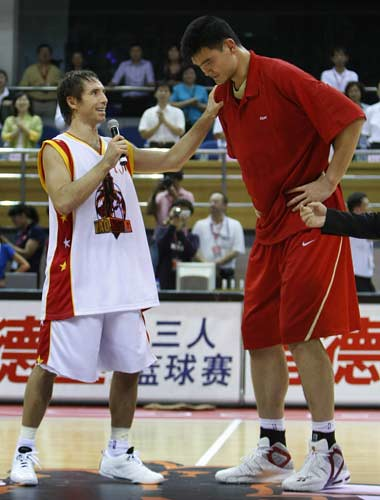 Steve Nash and Yao meet at half court Friday night after the charity game they held in Beijing to benefit poor children in Western China.  Yao scored 21, while Nash scored 13.