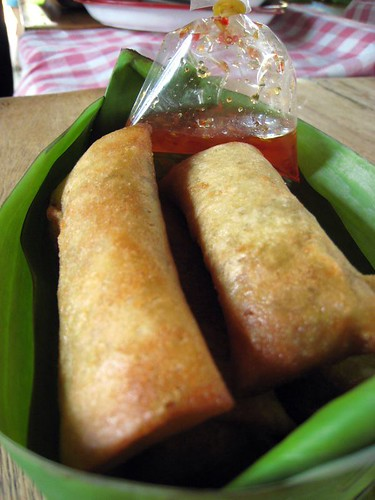 Spring rolls, finished and in a banana leaf boat