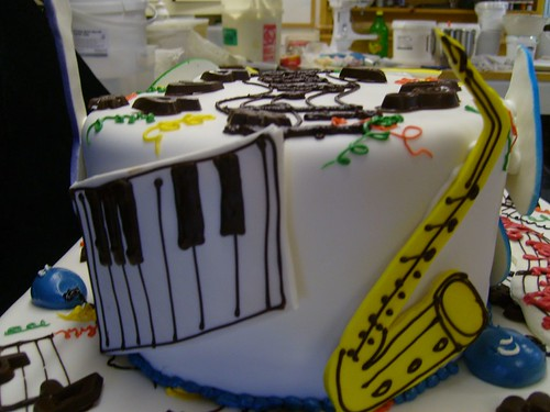 Music-themed cake  - cut-out keyboard and saxaphone