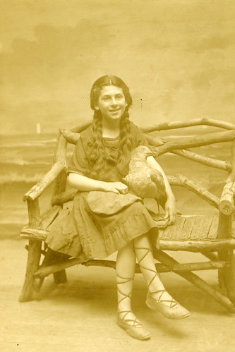 Real photo postcard, girl with faux seagull