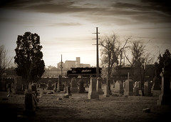 2046 Passing Riverside (jrlarimer) Tags: bw cemetery train riverside d100 tombstones