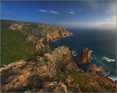 Sunset Approaches Cabo da Roca (Pear Biter) Tags: ocean sunset lighthouse portugal water geotagged interestingness surf waves lisboa lisbon pano sintra rocky cliffs portuguese 1022mm hdr 30d cabodaroca vacationphoto atlanticcoast dontlookdown westernmost mywinners abigfave holidaysvancanzeurlaub geo:lat=38780442 geo:lon=9498914 faroldocabodaroca portugueseriviera