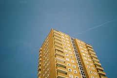 Sandcastle (antikewl) Tags: sky building film 35mm airplane brighton apartment hove olympus aeroplane xa2 flats trail block expired vapour vapor